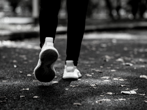 A black and white photograph of just a runner